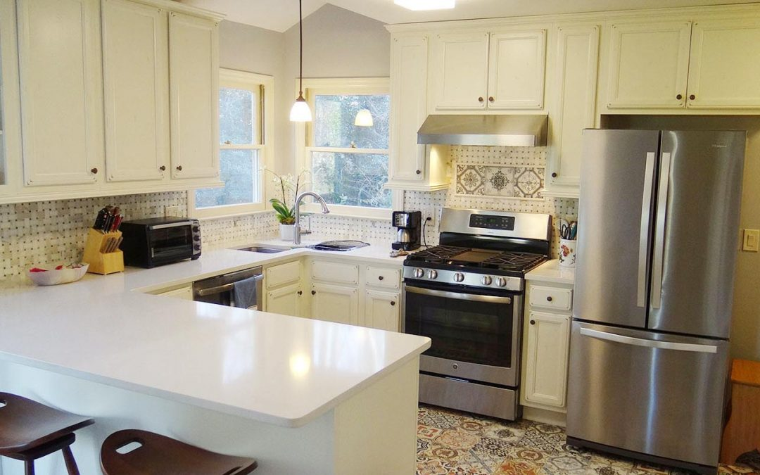 Vintage Kitchen Design: white cabinets and colored Moroccan tiles